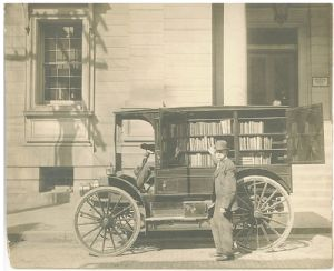 The library and the first motorized travelling library.