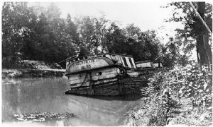 Boat 85 half sunk in canal
