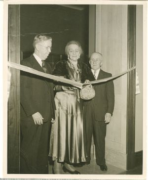 Anna Brugh Singer cuts the ribbon at the opening of the two new wings.