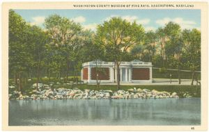 Early postcard showing Museum and lake.